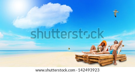 Portrait Of Happy Beautiful Couple Enjoying their summer holidays on a tropical beach - stock photo