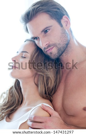 Portrait of happy beautiful couple in white - stock photo