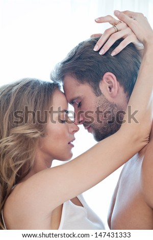 Portrait of happy beautiful couple isolated on white - portrait - caucasian - stock photo