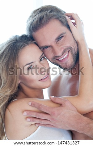 Portrait of happy beautiful couple smiling in white - (pregnant, young, caucasian) - stock photo