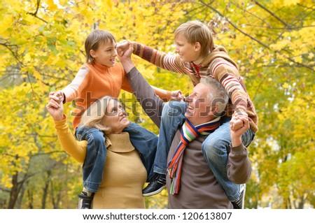 portrait of happy beautiful elderly couple and grandchildren - stock photo