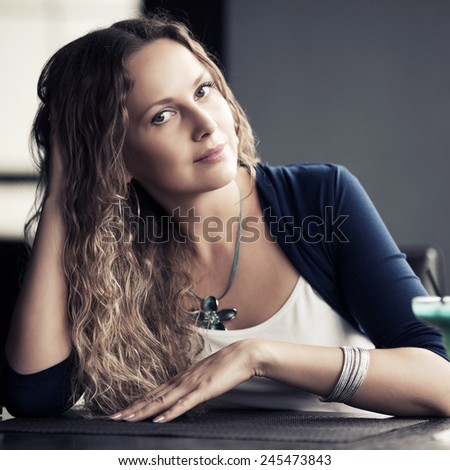Portrait of happy beautiful woman with long curly hairs - stock photo