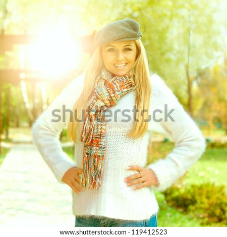 Portrait of happy beautiful young woman outdoors. - stock photo
