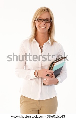 Portrait of happy blonde businesswoman holding tablet, smiling at camera. - stock photo