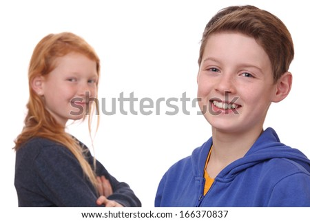 Portrait of happy boy and girl on white background - stock photo