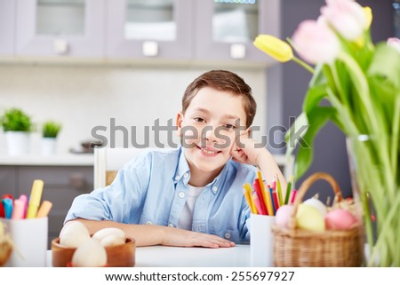 Portrait of happy boy looking at camera - stock photo