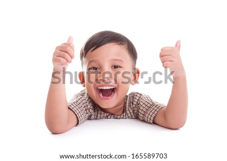 Portrait of happy boy showing thumbs up gesture, on white background - stock photo