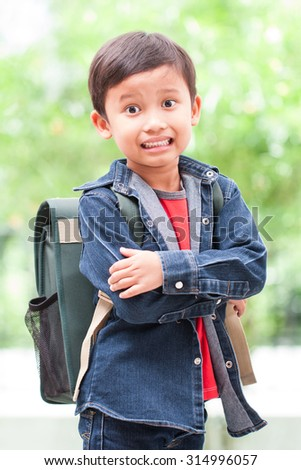 portrait of happy boy walking to school - stock photo