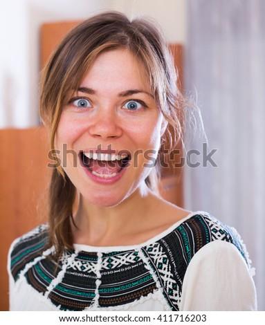 Portrait of happy brunette girl in domestic interior - stock photo