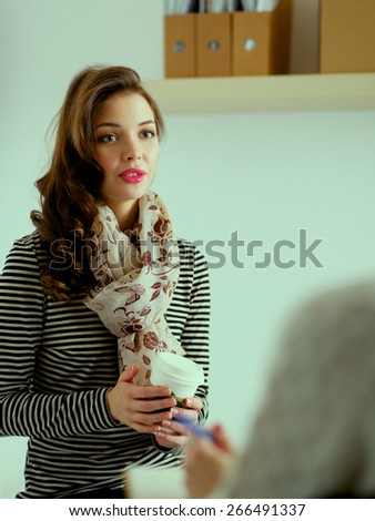 Portrait of happy brunette with mug in hands - stock photo