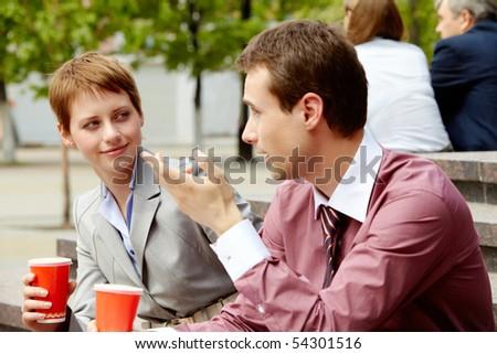 Portrait of happy business partners having break outside at summer - stock photo