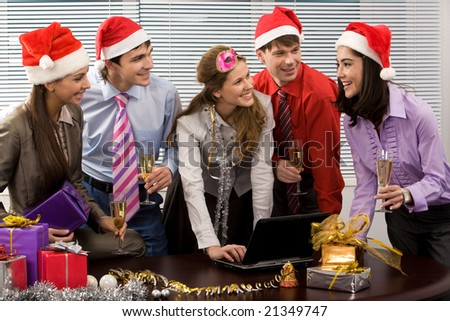 Portrait of happy business people chatting while celebrating Christmas in office - stock photo