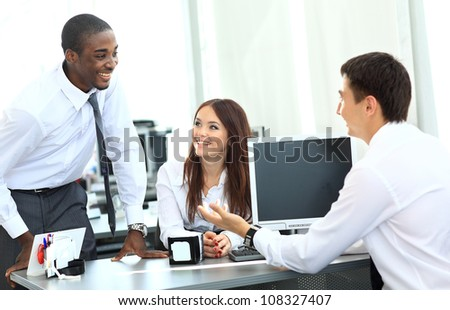 Portrait of happy business team having meeting in office - stock photo