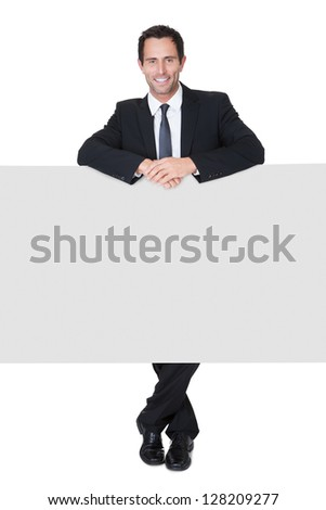 Portrait of happy businessman presenting empty banner. Isolated on white - stock photo