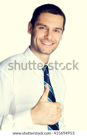 Portrait of happy businessman showing thumbs up hand sign gesture. Caucasian male model at studio shot. Business and success concept. - stock photo