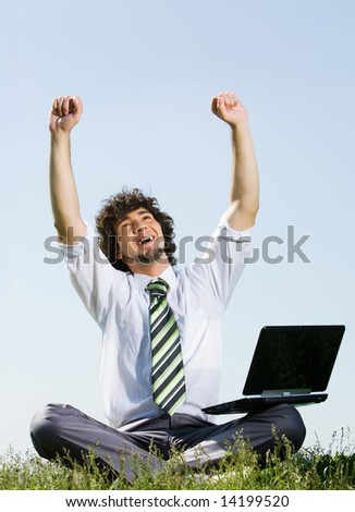 Portrait of happy businessman with laptop demonstrating a working luck - stock photo