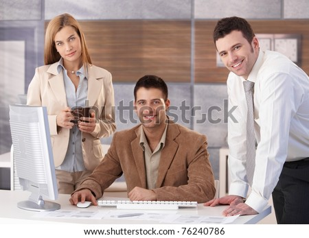 Portrait of happy businessteam working together at desk in office.? - stock photo