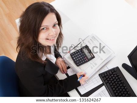 Portrait Of Happy Businesswoman Working In Office - stock photo