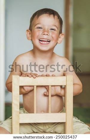 Portrait of Happy Caucasian Boy. Vertical Image Composition - stock photo