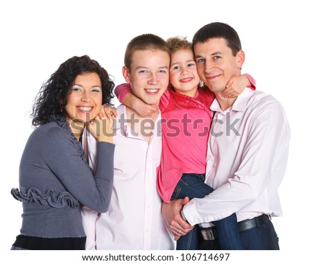 Portrait of happy Caucasian family smiling together on white background - stock photo