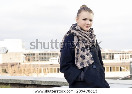 Portrait of Happy Caucasian Teenager Girl Relaxing Outdoors. Horizontal Image Composition - stock photo