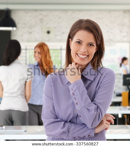 Portrait of happy caucasian woman at office. - stock photo