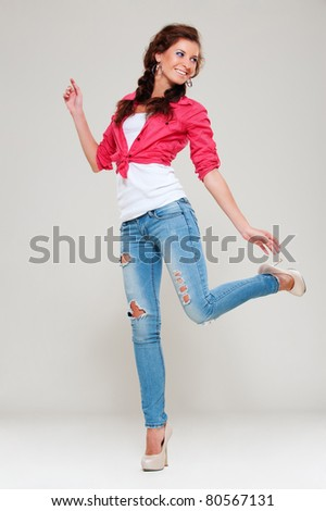 portrait of happy cheerful woman over grey background - stock photo