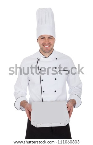 Portrait of happy chef holding pizza box. Isolated on white - stock photo