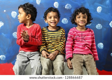 portrait of happy children Indian, blue background - stock photo