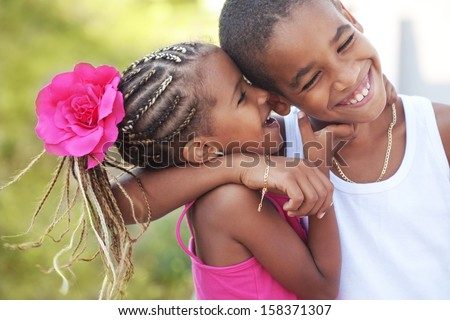 Portrait of happy children playing outdoors - stock photo