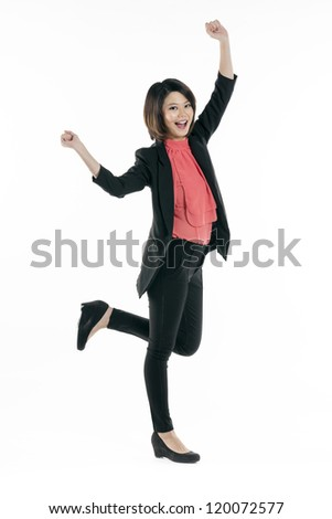 Portrait of happy Chinese woman celebrating with her arms in the air. Isolated on a white background. - stock photo