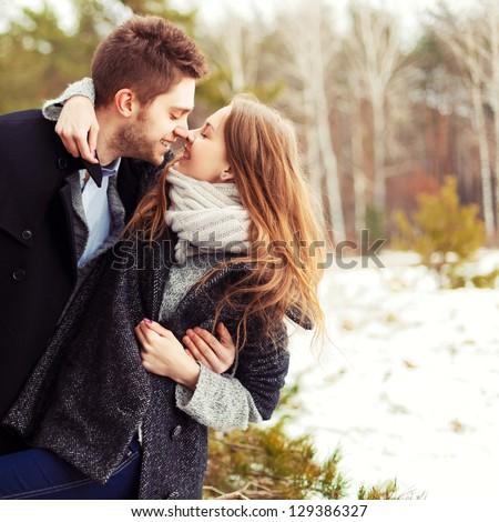portrait of happy couple at winter resort - stock photo