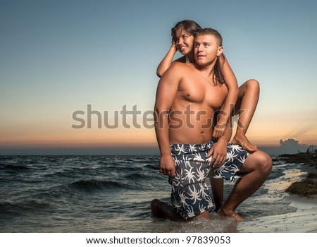 portrait of happy couple enjoying vacations - stock photo