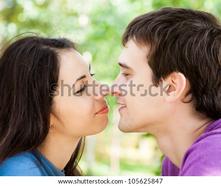 Portrait of happy couple in love outdoors - stock photo