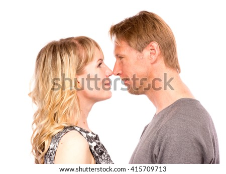 Portrait of happy couple nose to nose, face to face, isolated on white background. Attractive man and woman being playful. - stock photo