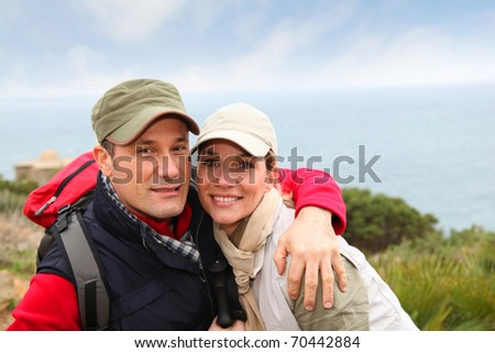 Portrait of happy couple on hiking day - stock photo