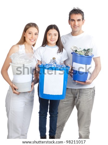 Portrait of happy couple smiling with daughter holding recycle bin. - stock photo