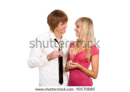Portrait of happy couple with glass of champagne looking to each other and smiling, isolated over white background - stock photo
