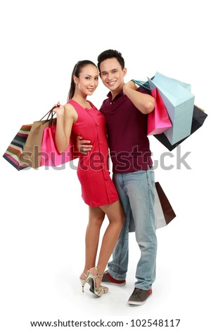 portrait of happy couple with shopping bags on white background - stock photo