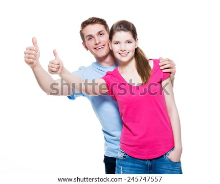Portrait of happy couple with thumbs up sign isolated on white background. - stock photo