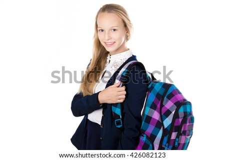 Portrait of happy cute beautiful blond schoolgirl wearing school uniform, holding checkered backpack with textbooks, posing, friendly smiling at camera, isolated studio shot, white background - stock photo