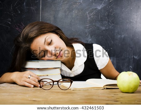portrait of happy cute real teen student in classroom at blackbo - stock photo