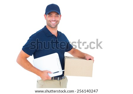 Portrait of happy delivery man with cardboard box and clipboard on white background - stock photo