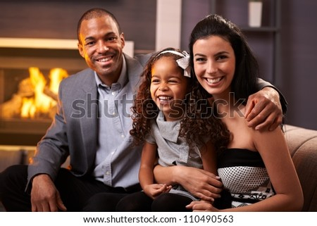 Portrait of happy diverse family at home, all smiling. - stock photo