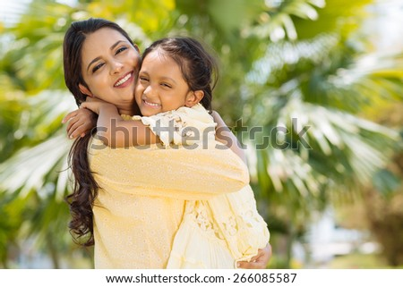 Portrait of happy embracing mother and daughter - stock photo