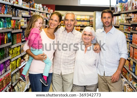Portrait of happy extended family at the supermarket - stock photo