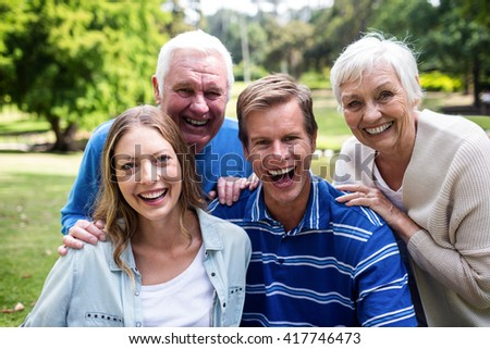 Portrait of happy family having a picnic in park on a sunny day - stock photo