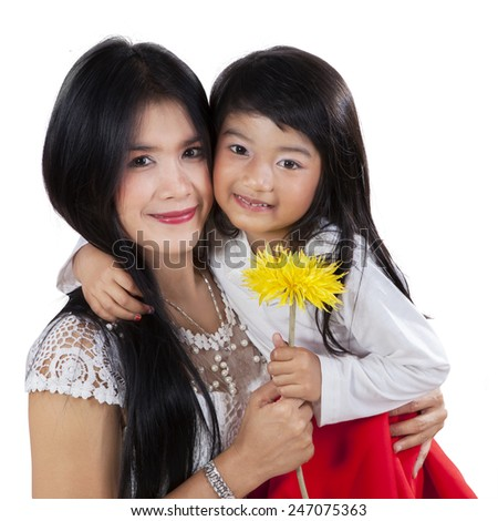Portrait of happy family holding a yellow flower in the studio, isolated on white background - stock photo