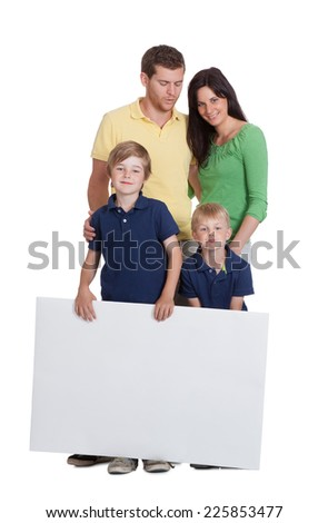 Portrait of happy family holding blank billboard against white background - stock photo