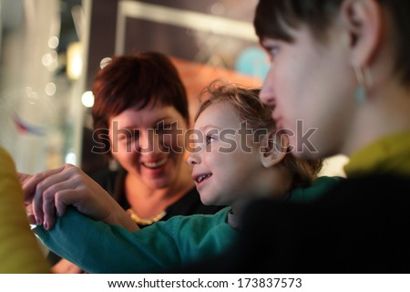 Portrait of happy family in a museum - stock photo